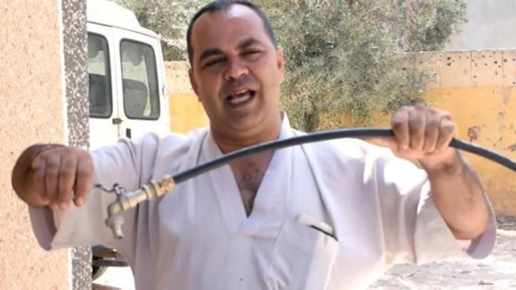 a man holding a dry hose